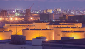 Oil tank at industrail zone and high building Royalty Free Stock Image