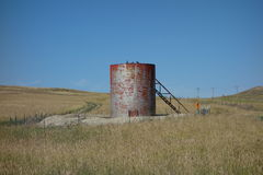 An oil tank in the prairies Royalty Free Stock Images