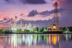 Oil tank ship mooring in oil refinery industry at twilight time Stock Photo