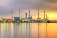 Oil tank ship mooring in oil refinery industry at twilight time Stock Image