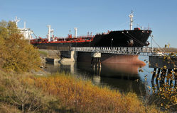 Oil tanker. Tanker unloading its petroleum in an autumn setting Royalty Free Stock Photo