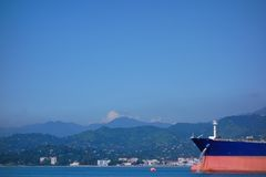 Oil tanker anchored outside Batumi oil terminal on a sunny summer day. A large size oil tanker floating in Black Sea and unloading water from its tanks while Royalty Free Stock Photography