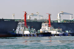 Oil Tanker And Two Tugboats Royalty Free Stock Images