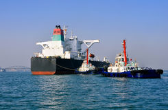 Oil Tanker And Two Tugboats Royalty Free Stock Photo
