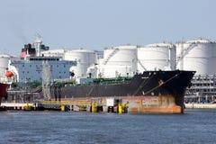 Oil tanker. ANTWERP, BELGIUM - JULY 9: Oil tanker near oil silos in the Port of Antwerp July 9,2013 in Antwerp, Belgium. The Port of Antwerp is the Europe's Royalty Free Stock Photo