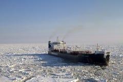 Oil tanker in the Arctic Sea. Oil tanker Mikhail Ulyanov in frozen sea Stock Photo