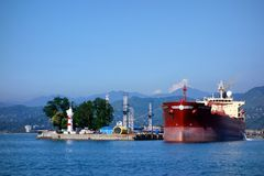 Oil tanker in Batumi oil terminal on a sunny summer day. A large size oil tanker loading crude oil in Batumi oil terminal on a cloudless sunny July day in 2014 Stock Photo