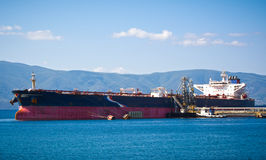 Oil tanker. Bringing its cargo in a tank storage facility Royalty Free Stock Images