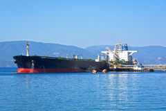 Oil tanker. Bringing its cargo in a tank storage facility Royalty Free Stock Photos