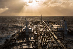 Oil tanker deck proceeding to the sun. In the open ocean Stock Photos