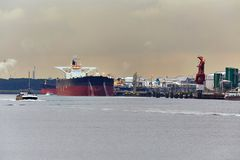 Oil Tanker in Dock. Large crude oil tanker arrived to the refinery dock Royalty Free Stock Images