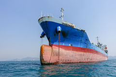 Oil tanker drop anchor. Cargo oil tanker blue and red color drop anchor one side stock images