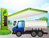 An oil tanker in front of a gasoline station Royalty Free Stock Image