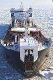 Oil tanker in the frozen sea. Oil tanker Mikhail Ulyanov in frozen sea Stock Image