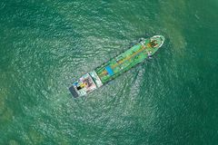 Oil tanker or gas tanker in open sea, Refinery Industry cargo ship, aerial view in import export LPG oil refinery, Logistics and. Transportation royalty free stock photo