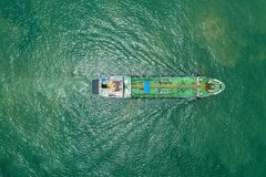 Oil tanker or gas tanker in open sea, Refinery Industry cargo ship, aerial view in import export LPG oil refinery, Logistics and. Transportation royalty free stock image