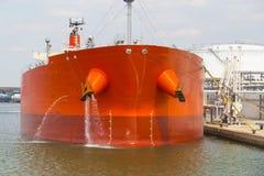 Oil tanker moored near an oil silo in Port of Antwerp Stock Photos