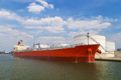 Oil tanker moored near an oil silo in Port of Antwerp Royalty Free Stock Image