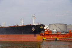 Oil tanker moored near an oil silo in Port of Antwerp Stock Photography