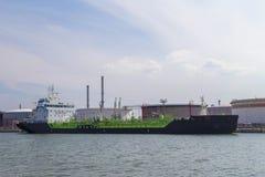Oil tanker moored near oil silo in Port of Antwerp Stock Image