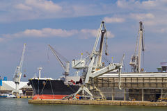 Oil tanker moored near an oil silo in Port of Antwerp Royalty Free Stock Photography