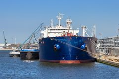 Oil tanker moored port. Oil tanker moored at an oil terminal in the Port of Antwerp Royalty Free Stock Photo