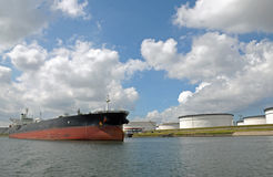 Oil tanker moored at storage terminal Stock Photography