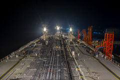 Oil tanker moored to hte berth at night. Big oil tanker moored to hte berth at night and ready to transfer the cargo to the terminal Royalty Free Stock Images