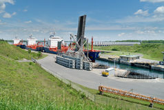 Oil Tanker Moving through locks Stock Photo