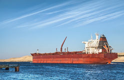 Oil tanker passes through the Suez Canal. Big red oil tanker passes through the Suez Canal Stock Photography