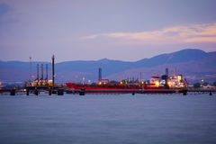 Oil tanker on a pier Stock Photo