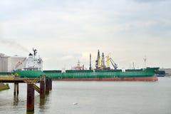 Oil tanker in the port of rotterdam. Oil tanker sailing near oil terminalin the harbor of rotterdam Stock Photo