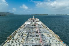 Oil tanker proceeding through Panama Canal by green jungle. Oil tanker proceeding through Panama Canal Stock Image