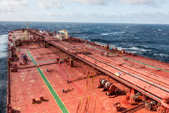 Oil tanker proceeding to skyline. Tanker deck with green stripe Royalty Free Stock Photos