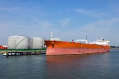 Oil tanker. A red large oil tanker moored Stock Photography