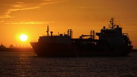 A Oil Tanker returning to the Kaohsiung port at sunset Royalty Free Stock Images