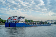 Oil tanker on river on sunny day Royalty Free Stock Image