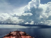 An oil tanker in the Indian ocean. An oil tanker sails in the waters of Indian ocean facing a terrible storm on its way Stock Images