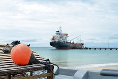 Oil tanker ship at dock with lobster pot trap and buoy  Picnic C Stock Image
