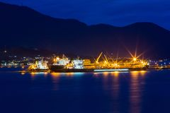 Oil tanker stocking up. Night photo of the sea. royalty free stock photos