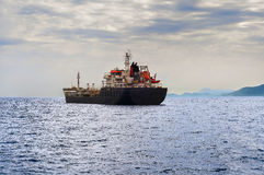 Oil tanker ship. Side view of oil tanker ship exporting fuel and sailing in the sea Royalty Free Stock Image