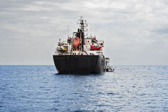 Oil tanker ship in the sea. The oil and petroleum tanker ship in the sea Royalty Free Stock Photo