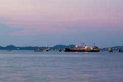 Oil tanker ship at seaport twilight time Stock Photos