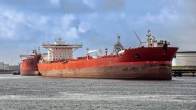 Oil tanker shipping port. Red oil tanker moored at an oil terminal in the Port of Rotterdam Royalty Free Stock Photography