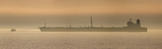 Oil tanker at sunset Royalty Free Stock Photography