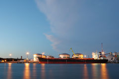 Oil tanker in terminal. Oil tanker standing near oil terminal in the evening Royalty Free Stock Images
