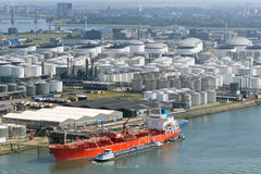 Oil tanker terminal aerial view. Aerial view on a oil tanker moored at a oil storage terminal Stock Photo