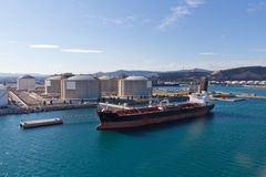 Oil Tanker at Terminal. Oil tanker moored at a oil storage terminal Royalty Free Stock Image