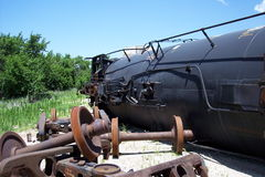 Oil Tanker Train Derailment Mock Disaster. A derailed oil tanker car with scattered rail wheels in the foreground. Taken at Crisis City, outside Salina, Kansas Stock Photos