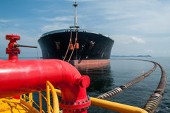 Oil tanker is transferring oil to the cargo vessel Royalty Free Stock Images